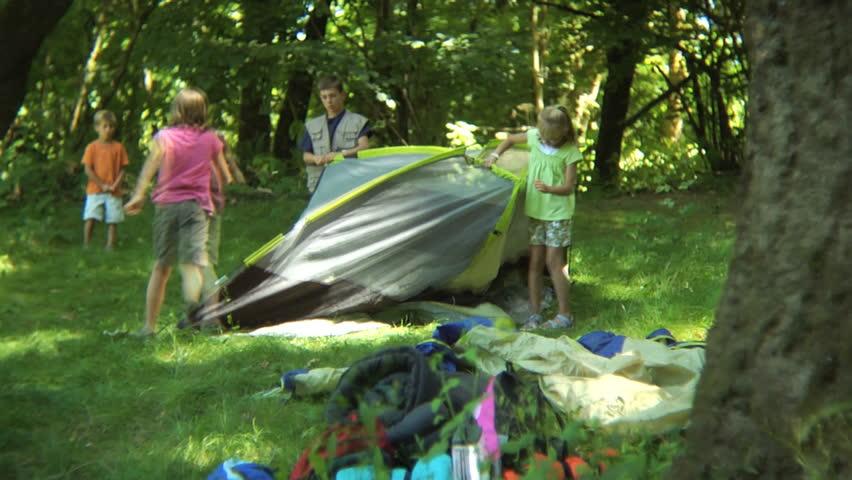 Timelapse shot of kids putting together tent