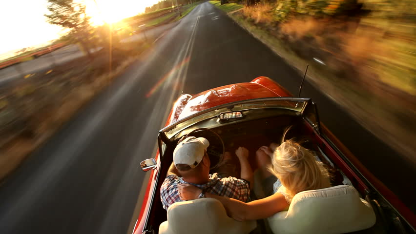 Couple in convertible car driving