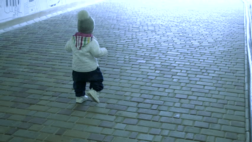 a small child walking in the tunnel alone towards the light