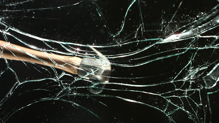 Hammer breaking glass, slow motion