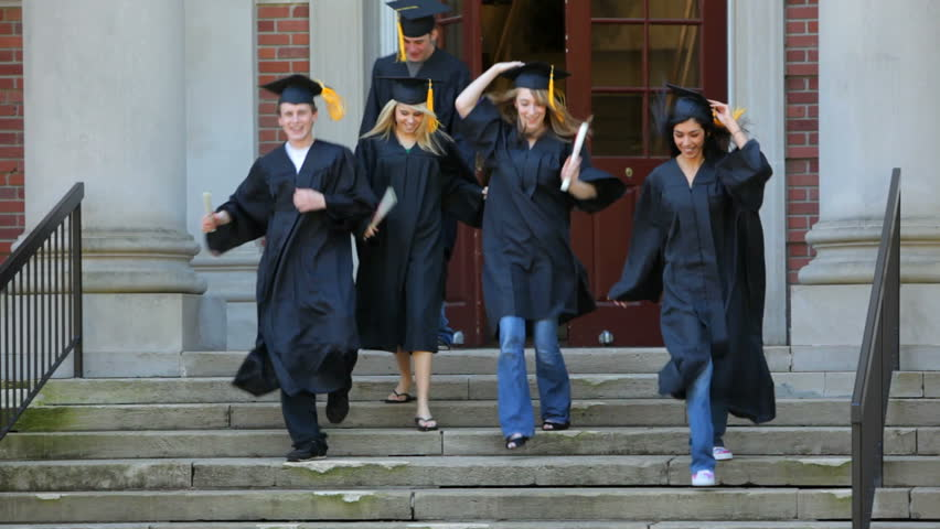 Happy graduates running from school