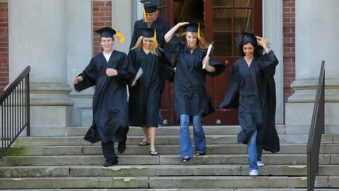 Happy graduates running from school