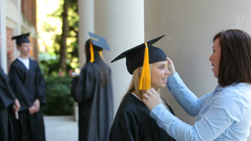 df7393d625f Mother Preparing Daughter for Graduation Stock Footage Video (100 ...