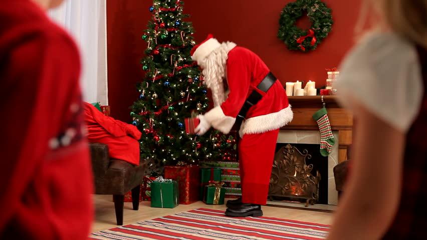 children watch santa claus hd stock video clip - Santa Claus Presents
