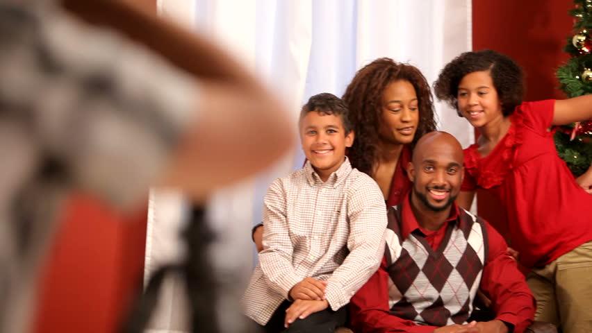 Photographer takes family portrait