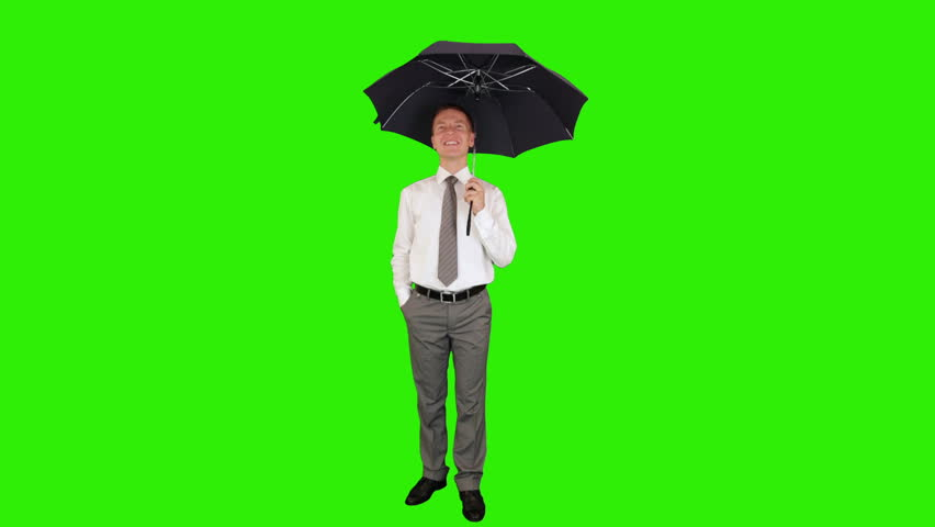Young businessman opening umbrella, Green Screen