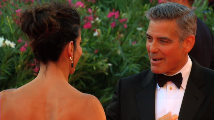 VENICE - AUGUST 28: Sandra Bullock and George Clooney on the red carpet for the movie