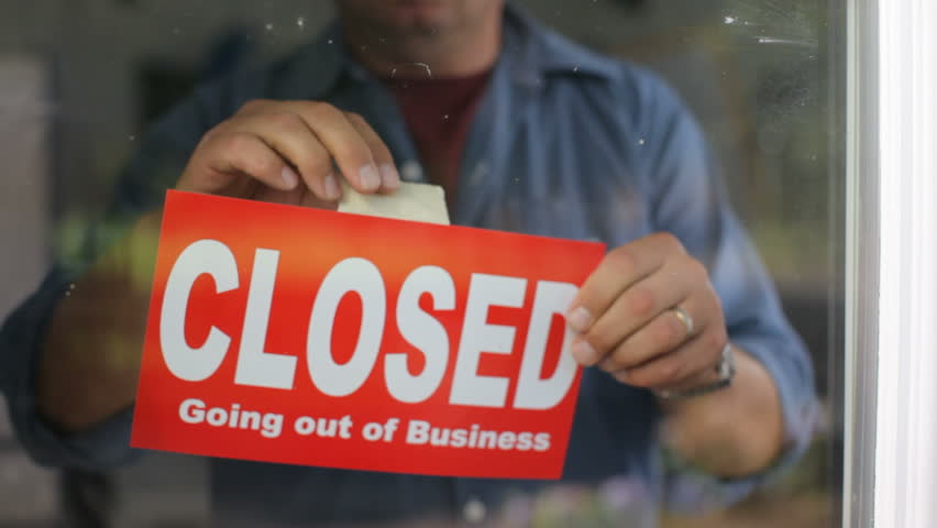 Going out of business, closed sign on window
