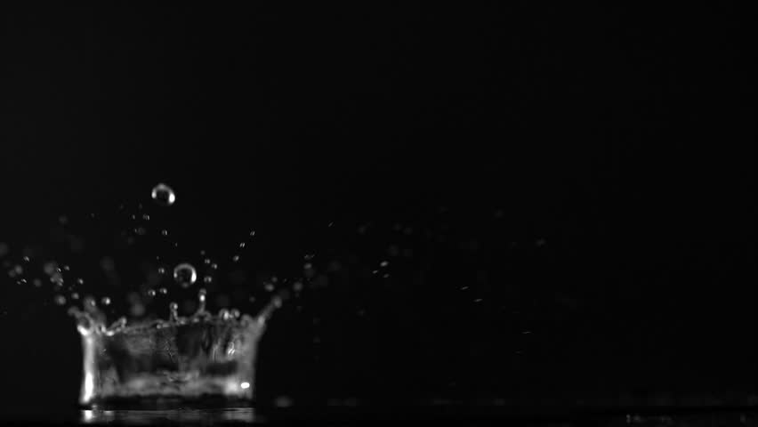 Water drop making splash on black background shooting with high speed camera, phantom flex. | Shutterstock HD Video #4630835