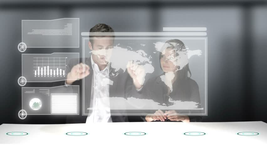 Two business professionals use a computer generated video wall to look over the stats of their company. Medium CG shot. | Shutterstock HD Video #4637144