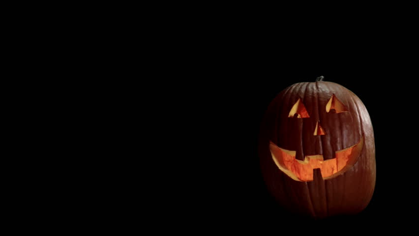halloween carved pumpkin on a black background with room for graphics hd stock footage - Halloween Background Video