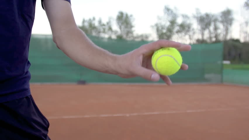 Slow Motion Shot Of A Professional Tennis Player Throwing And Catching A Tennis