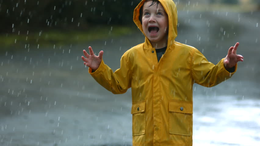 Young boy playing in rain, slow motion #4654475