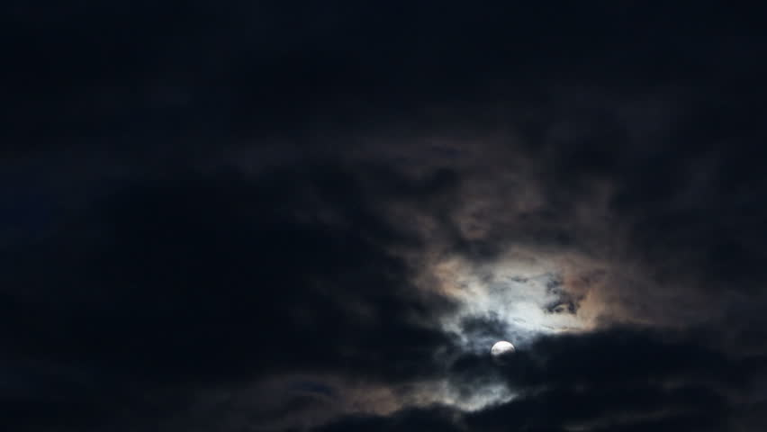 Moon rising through clouds. Time lapse.  | Shutterstock HD Video #4659335