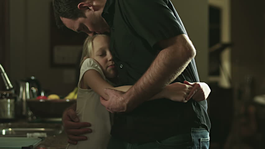 Sad father gets hugs from daughters