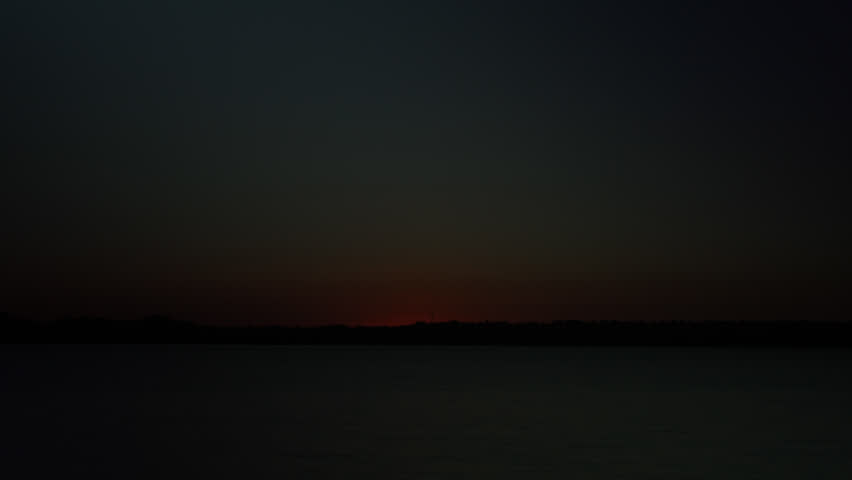 Timelapse of a Fiery sunrise over a Colorado Lake. HD 1080p