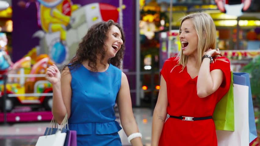 Tilt up of two lovely ladies enjoying their shopping weekend | Shutterstock HD Video #4685135