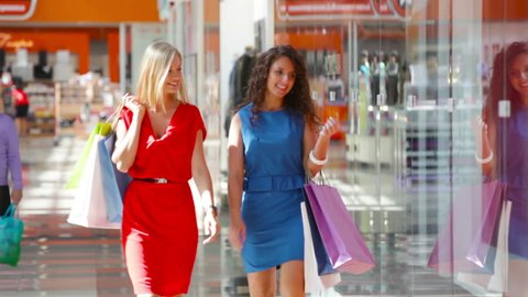 Lovely friends being excited about shopping sales