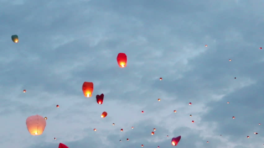 flying wishes (chinese lanterns) in the sky