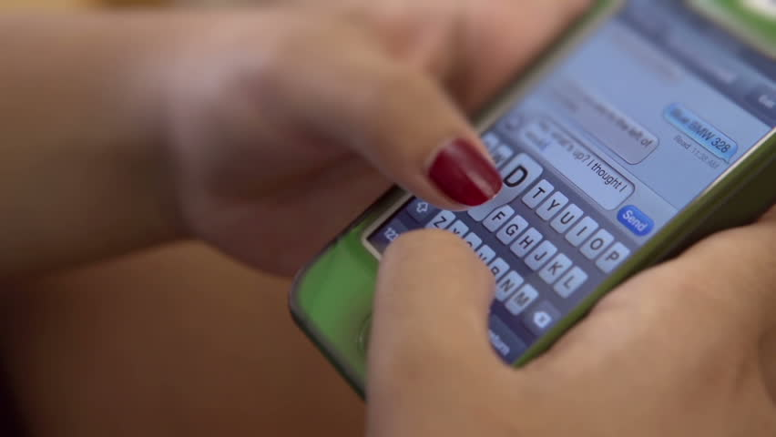Fingers of female texting on cell phone | Shutterstock HD Video #4698665
