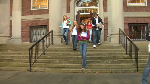 College students walking out of building