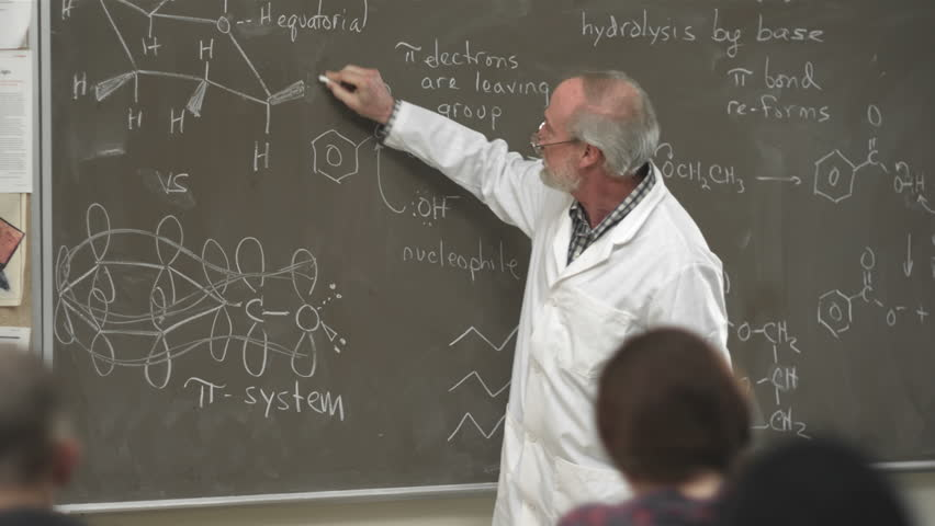 A college professor calls on a student raising their hand in class | Shutterstock HD Video #4746572
