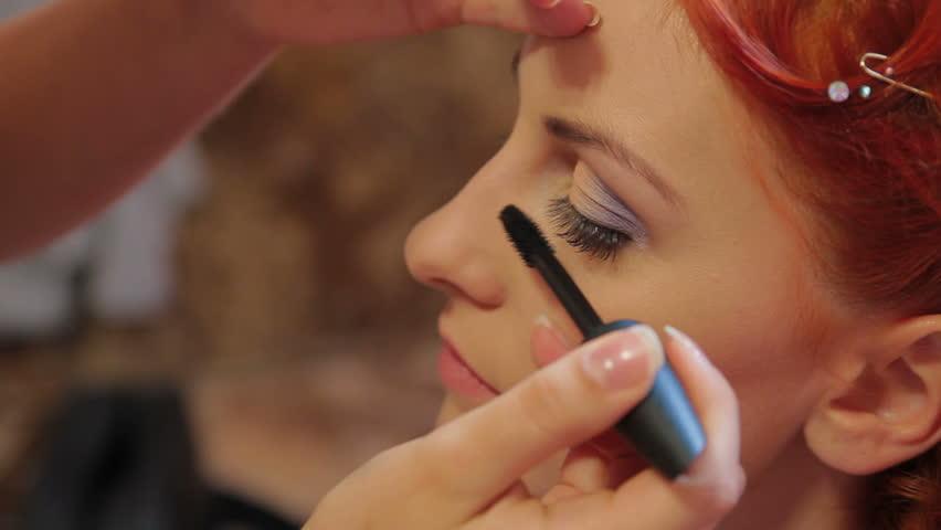 Makeup artist putting on mascara. Close-up. Putting on mascara.