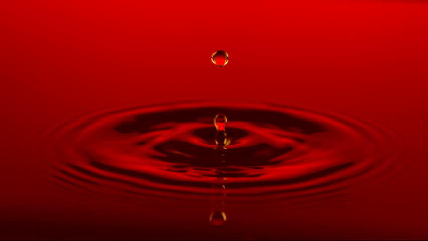 Red water drop, slow motion