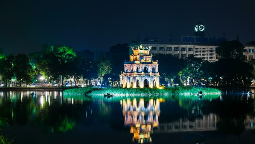HANOI - 16 SEPTEMBER: Panning Time Lapse view of Turtle Tower on Hoan Kiem lake