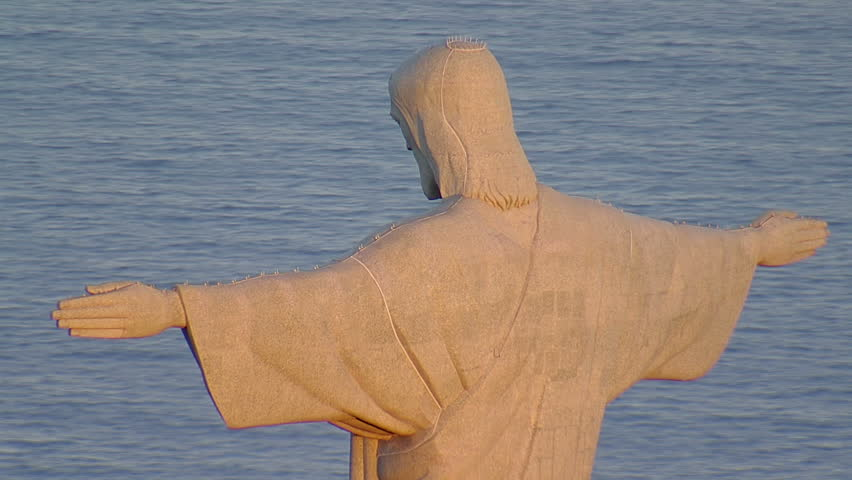 Closeup aerial zoom out from Christ the Redemeer Statue at Sunset, Rio de Janeiro, Brazil