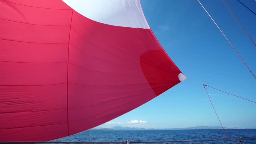 sail blows in the wind on boat in navigation