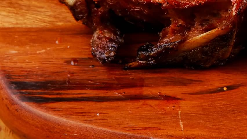 Meat savory on wooden plate: roast ribs with peppers tomato and dry spices over wooden table 1920x1080 intro motion slow hidef hd | Shutterstock HD Video #4772165