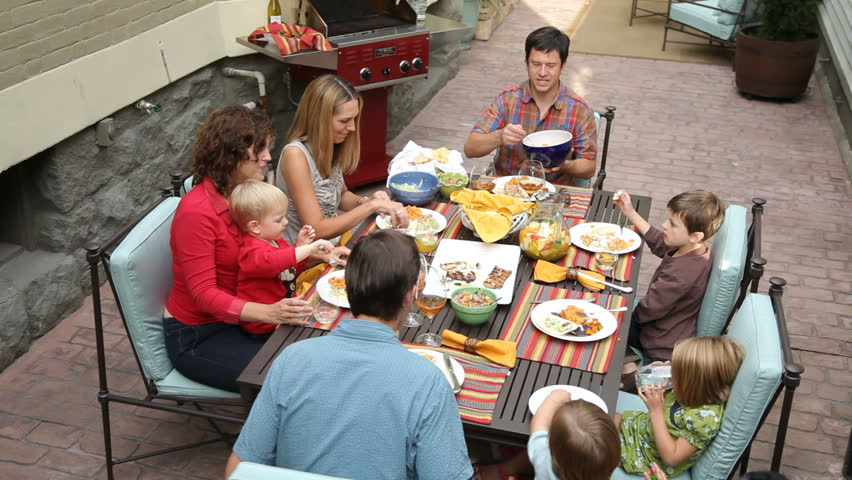 Portrait of family eating on patio | Shutterstock HD Video #4775744
