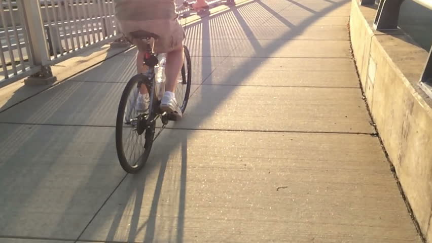An extreme slow motion 120fps shot of a man riding his bicycle on a Pittsburgh