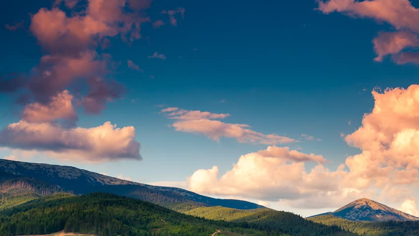 Time lapse clip. Majestic mountain landscape with colorful cloud. Dramatic sky.