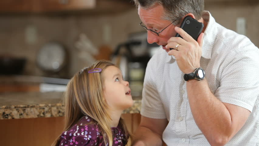 Grandfather talking on phone with granddaughter