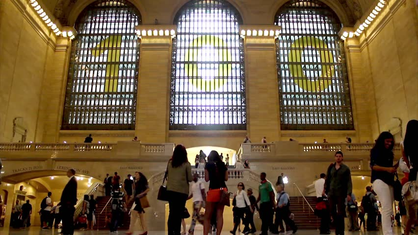 NEW YORK, SEPTEMBER 03: Passengers in grand central station in September 03, 2013 in New York. It is the busiest and largest train station in the world by number of platforms: 44, with 67 tracks