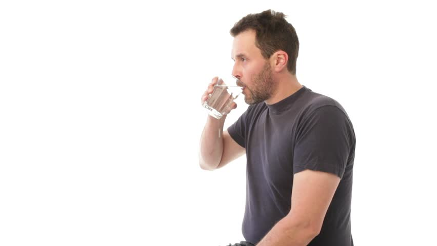 Mature man drinking a glass of water