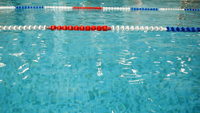 Swimming Pool Lanes Background buoys mark lap lanes in a swimming pool. stock footage video