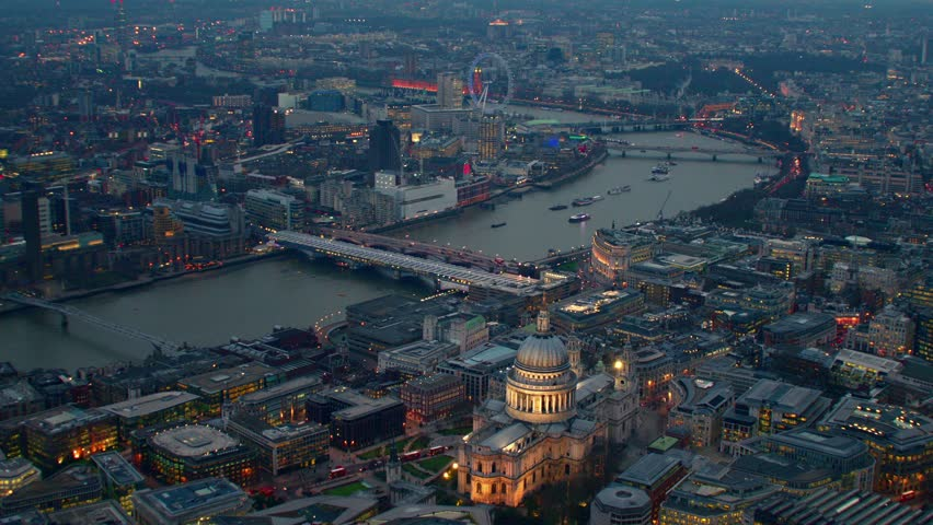 Aerial view along the River Thames in Central London, UK. Showing St Paul's Cathedral, The Millennium Wheel (London Eye) & Waterloo district. | Shutterstock HD Video #4836275
