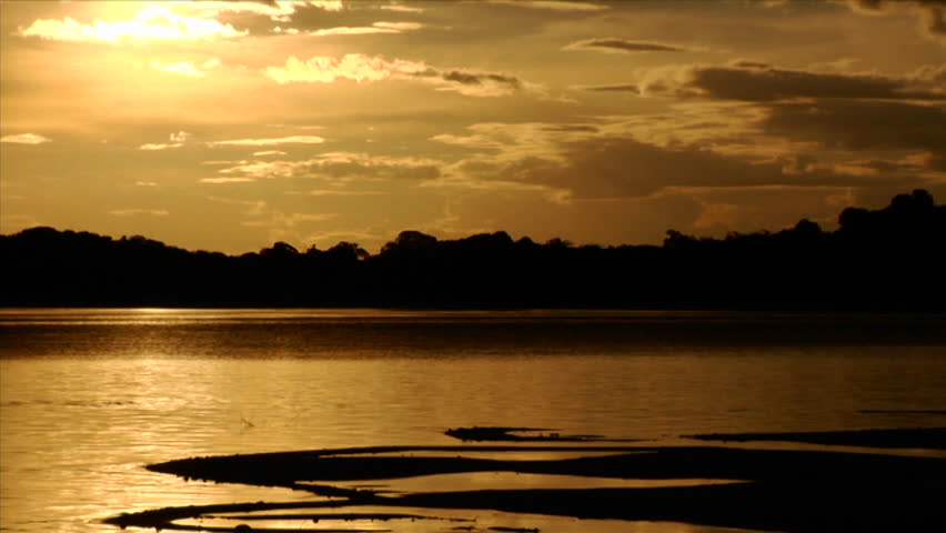 Time lapse shot of the sun setting behind the Amazon River in Brazil.