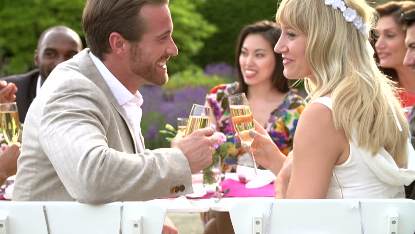 Dinner Party Video Part - 41: Smiling Loving Bride And Groom Toast At Small Outdoor Wedding Dinner Party  Close Up Slow Motion