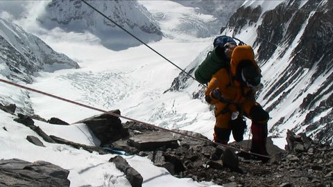 MT. EVEREST - CIRCA 2010: Climber ascending rocky patch on ropes