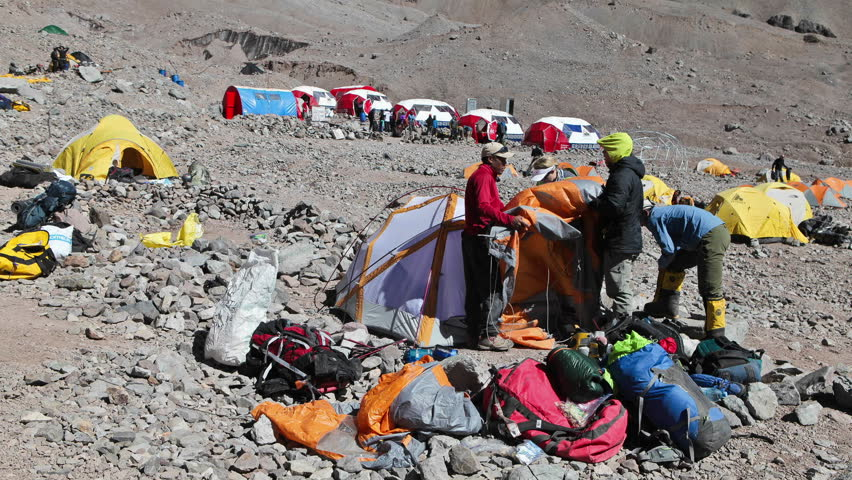 ACONCAGUA, ARGENTINA - CIRCA 2010: Aconcagua Time Lapse - Climbers packing at basecamp
