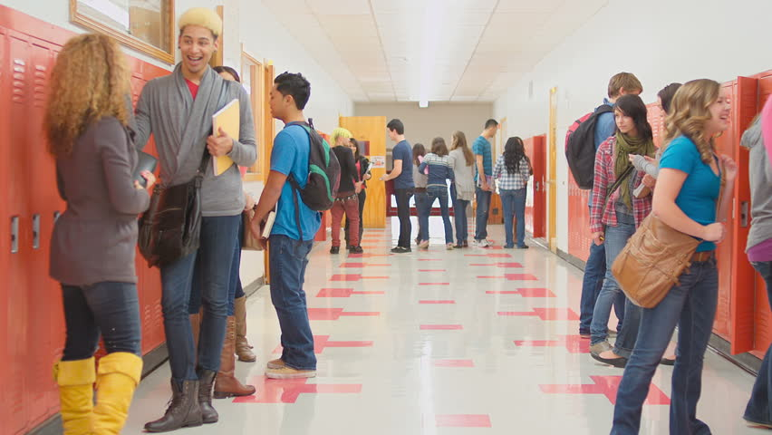 Students Stand Around A School Hallway Waiting For Class ...