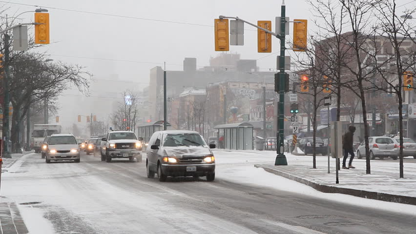 TORONTO, CANADA on JAN 19th: Traffic on Spadina Avenue during a snowstorm in Toronto, Canada on January 19, 2012. Spadina Avenue is one of the most prominent streets in Toronto.