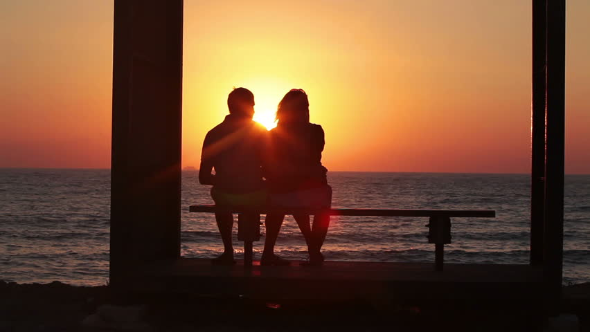 Setting Sun Between Silhouettes Of Two Loving Royalty Free Video