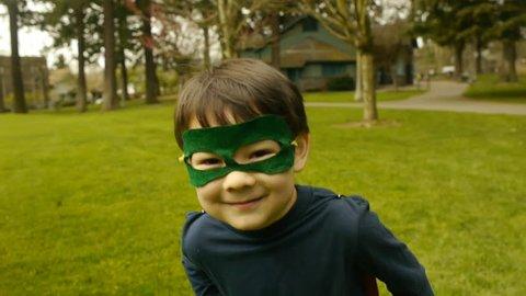 Superhero Boy Runs Toward Camera