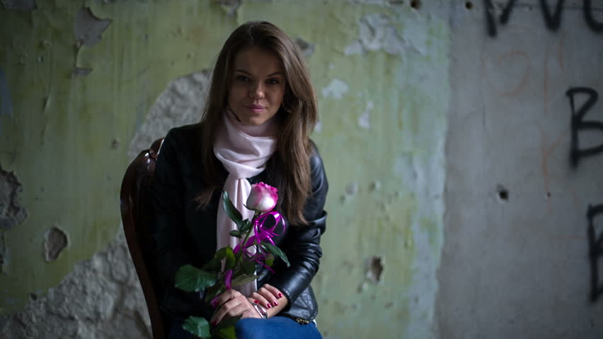 A Girl With Rose At The Wall. RAW HD Video 1