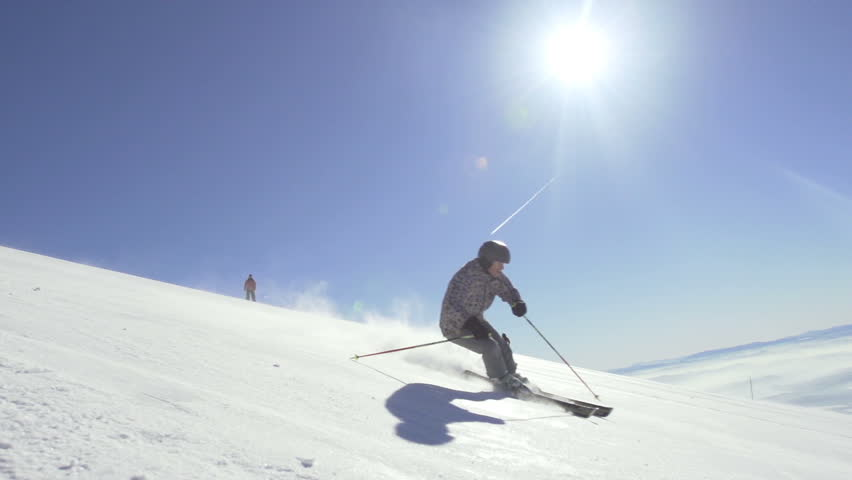 Slow Motion Of A Professional Skier Skiing Downhill With Sun Shining